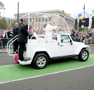Pope Francis waves to the crowd as he arrives for the outdoor Mass in Philadelphia on Sept. 27, the final day of his six-day visit to the United States. Pilgrims from the Lafayette