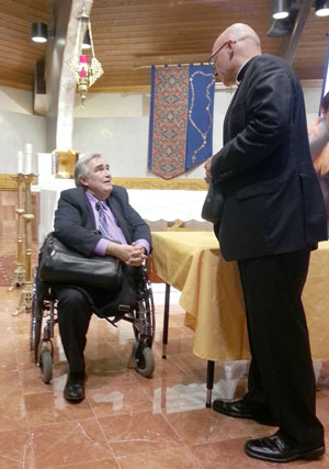 """Speaker Al Kresta greets Bishop James S. Wall of the Diocese of Gallup, N.M., after his presentation at Our Lady of Mt. Carmel Parish in Carmel on Oct. 3. Kresta is president and CEO of Ave Maria Radio and host of """"Kresta in the Afternoon."""" (Photo by Brigid Curtis Ayer)"""