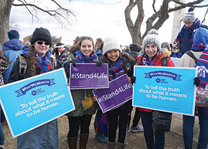 Hundreds of pilgrims from the Lafayette diocese traveled to Washington for the 44th annual March for Life on Jan. 27. Among them, from left, were Eugenia Hensley, Sara Siener, Iza De Los Reyes and Samantha Coffing, all members of the Greater Lafayette Antioch Youth Group. (Photo by Caroline B. Mooney)