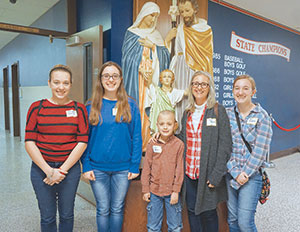 "Jenny Goeppner of Covington attended this year's conference with her children Berna-dette, 13, Daisy, 14, Fulton, 7, and Mary, 17. ""We come because this is for the whole family,"" she said. (Photo by Caroline Mooney)"