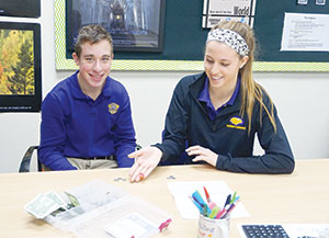 Reiley Harrington works as a peer tutor with Trevor King, the first student in the new Wings Academy.